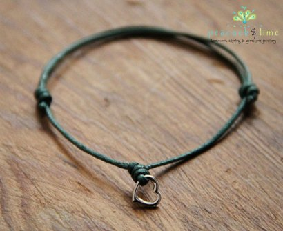 heart wish bracelet on green