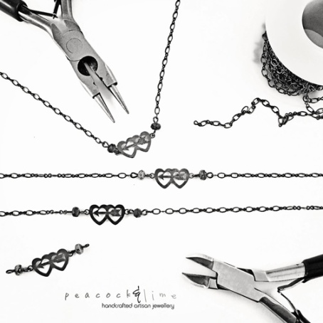 double-heart-and-arrow-necklace-3---black-and-white-logo